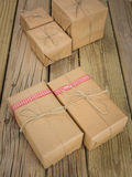 String and brown paper parcels decorated with ribbon Stock Photography