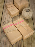 String and brown paper parcels  with ribbon and twine Stock Photos