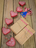 String and brown paper parcels with scissors, ribbon  and hearts Stock Photo