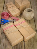 String and brown paper parcels with scissors, ribbon  and string Stock Photography
