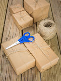 String and brown paper parcels with scissors and string Royalty Free Stock Photo