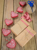 String and brown paper parcels with scissors, string, ribbon  an Stock Photography