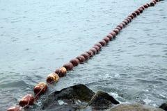 String of buoys Royalty Free Stock Image