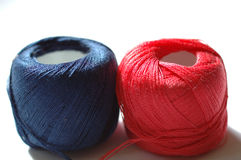 String clews. Red and blue string clews on white background royalty free stock image