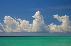 String of clouds above Florida Bay. White fluffy cumulus clouds above Florida Bay Royalty Free Stock Image