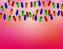 String of Color christmas light bulbs on red Background. Stock Photography