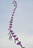 A string of colorful chinese kites before blue sky Stock Photography
