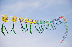 A string of colorful chinese kites before blue sky Royalty Free Stock Photography