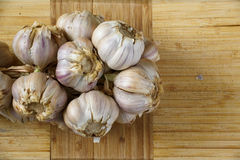 String of garlic. On wooden background Royalty Free Stock Images