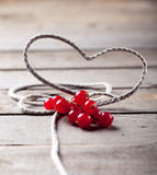 String heart with red currans Stock Photo