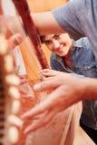 String instrument`s repair team Stock Images