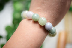 A string of jade beads wearring on wrist Stock Photos
