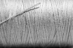 String and needle. To sew clothes in gray color stock photography