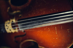 String of old shabby cello Stock Images