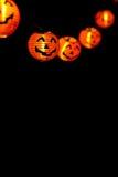 String of orange jack-o-lanterns Stock Photo