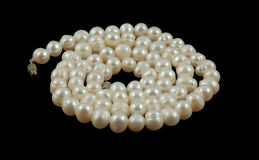 String of pearls. Isolated on black Royalty Free Stock Images