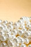 String of pearls. On golden surface royalty free stock photography