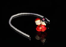 A string of pearls and China style Wedding Doll Royalty Free Stock Photos