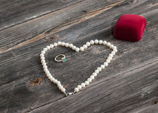 String of pearls and engagement ring Royalty Free Stock Image