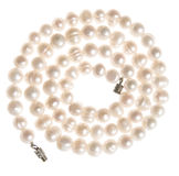 String of pearls in spiral shape. Overhead view of string of pearls in spiral shape, white background Stock Photography