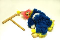 String Puppet. Unemployed puppet laying on the floor instead of hanging from strings on wooden control royalty free stock photos