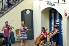 String Quartet busking in convent garden central piazza Stock Photo