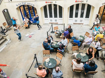 String quartet performs for diners on lower level of Covent Gard. London, England, August 20, 2015: String Quartet performs for diners at lower level tables at Stock Images