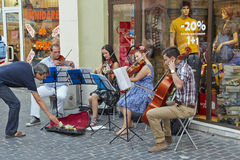 String quartet playing dowtown Royalty Free Stock Photography