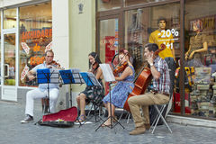 String quartet playing on the street Stock Photo