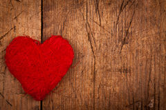String red heart on wooden background Royalty Free Stock Photos