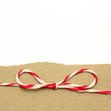 String red and white on brown wrapping paper Stock Photo