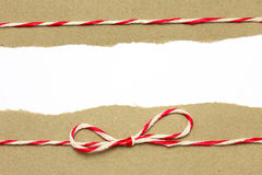 String red and white on brown wrapping paper Royalty Free Stock Photos