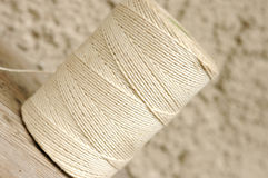 String roll. White string roll in diagonal composition Stock Image