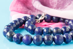 A string of round lapis lazuli beads Stock Photo