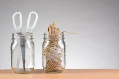 String and Scissors in Jars Royalty Free Stock Image