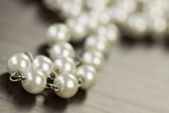 String of shiny grey beads Stock Image