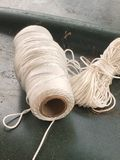String on a spool. White String wrapped around a spool Royalty Free Stock Images