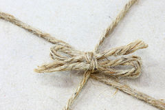 String tied in a bow  brown recycled paper Royalty Free Stock Image