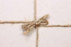 on String tied in a bow  brown recycled paper Stock Photography