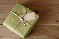 String Tied Parcel with Label and Green Floral Wrapping Paper Stock Photos