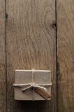 String Tied Parcel on Rustic Old Oak Wood Table Royalty Free Stock Photography
