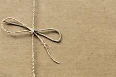 String Tied on Recycled Paper. Twine with great textures Stock Photo