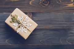 String or twine tied in a bow on kraft paper. Above gift box on royalty free stock photography