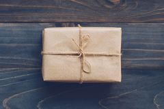 String or twine tied in a bow on kraft paper gift box no wooden stock image