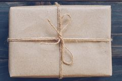 String or twine tied in a bow on kraft paper gift box texture royalty free stock photo