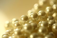 String of white pearl. In golden toning Stock Photography