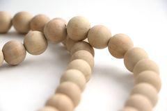 String of wooden beads necklace royalty free stock images