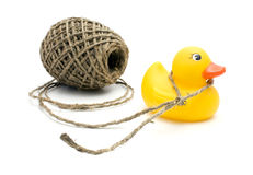 String and yellow duck. Royalty Free Stock Photo