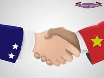 Stringa la mano fra il tipo americano ed il tipo di vietnamita Immagine Stock