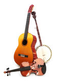 Stringed music instruments. Guitar, banjo, violin on a white background Royalty Free Stock Photos